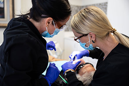 Doctors operating on a patient at Reich Dental Center in Smyrna and Roswell, GA